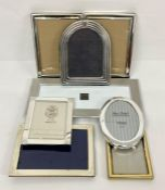 A selection of various sizes photo frames to include one sterling silver stamped 925