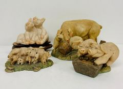 Four pigs figures by various makers