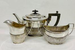 A WH & S Cross arrows tea service comprising teapot, sugar bowl and milk jug.