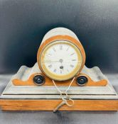 A wooden mantle clock