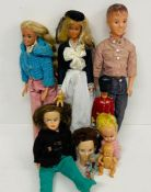 A large selection of various dolls