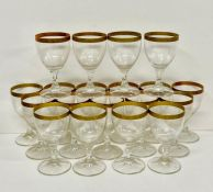 Nineteen wine glasses with gilt rim