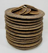 A collection of twelve rattan place matts and coasters.