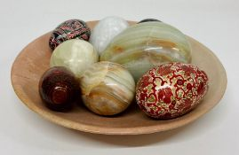 A selection of onyx and wooden eggs