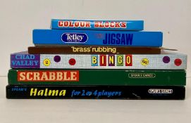 A selection of six boxed puzzles and games to include, Colour Blocks, Bingo, Scrabble, Brass