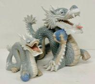 A selection of porcelain Dragon statue figures