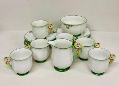 A Standard China 'Daisy Shape' tea service, six place settings to include tea cups, sugar bowl, milk