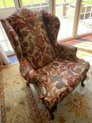 A Fabric covered Wing Back chair 74cm w x 110cm h x seat height 49cm