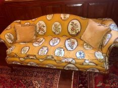 A sofa on orange grounds with a fruit theme (210 cm x 90 cm h x 50 cm seat height)