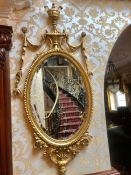 A gilt look mirror AF with swag details 128 cm high by 64 cm wide