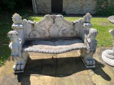 A substantial pair of marble ornate garden benches (160 cm w x 60 cm d x 95cm h) and a centre