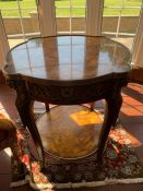 A Center table 61cm diameter by 74cm high