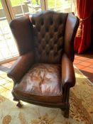 A Brown button back club chair 81cm w x 110cm h x 49cm seat height.