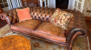 A Brown Leather Chesterfield style sofa 240 cm w x 78cm d x Seat height 44cm