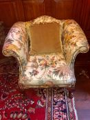 A Fabric covered wing arm chair with a monkey theme 94 cm wide x 86 cm high, seat height 44cm