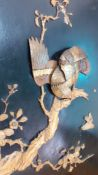 A Japanese Shibayama plaque depicting an eagle about to hunt, carved with inlays of faux ivory and