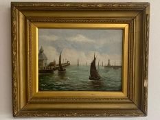 An oil on canvas of 'Sailing boats in harbour' within a gilt frame (Frame size 39x46.5cm)