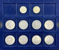 A selection of eight five pound coins and two two pound coins.