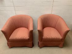 A pair of tub chairs with red upholstery