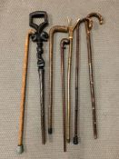 A Large collection of walking sticks including an African tribal stick.