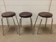 Three chrome stools