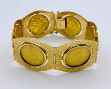 A Six sovereign bracelet set in 18 ct gold (Total Weight 87g) Date of coins 1892, 1911, 1892,