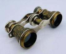 A pair of Vintage Opera glasses with Egyptian decoration.