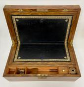 A reproduction mahogany writing box with brass corners