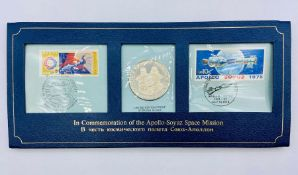 The Partners in Space commemorative Sterling silver coin and stamp set.
