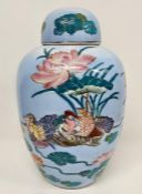 An oriental ginger jar with birds of paradise to sides