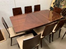 A hi-gloss contemporary dining table and eight chairs by ALF group with one centre leaf