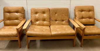 A Mid Century wooden suite with faux leather seats