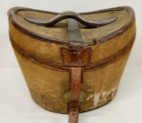 A Canvas and Leather Hat Box containing a Moss Boss Grey Top Hat (Size 6 3/4)
