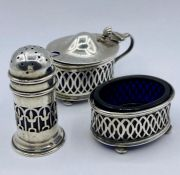 A Three piece silver condiment set with blue glass liners