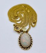 A 9ct gold chain with Opal pendant (Total weight 9g)