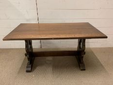 An oak coffee table with peg sides by J.C (H46cm W90cm D46cm)