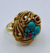 A gold metal and turquoise ring