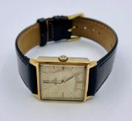 Omega Automatic square faced watch on leather strap.