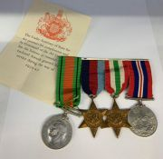 WWII Medal Bar comprising War Medal, Defence Medal, Italy Star and 1939-45 Star.