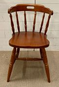 A spindle back wooden chair with stretcher to legs