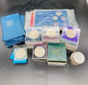 A large quantity of British commemorative crowns, and some coins sets