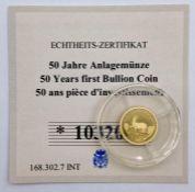A 0.5g 14ct (585) collectable gold coin 50 Francs CFA Congo
