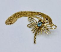 A 9ct gold dragonfly brooch on chain.