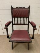 A spindle back folding chair