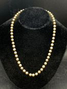 A Pearl necklace with a 9ct gold and semi precious stone clasp
