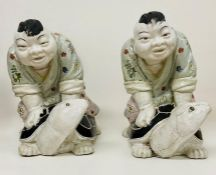 A pair of china sumo's wrestlers riding tortoise