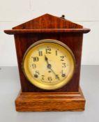 A Seth Thomas wooden mantel clock