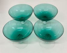 Four vintage green glass bowls on clear stems