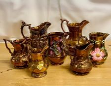 A selection of seven various lustre ware jugs.