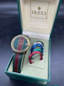 A Gucci vintage watch 1200 with International warranty card.